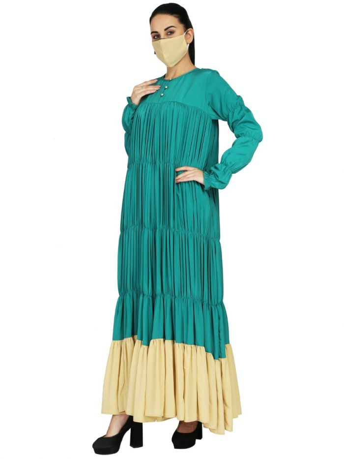Designer Dress With Elasticated Body And Sleeves.